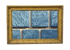 Detail of the facade with blue squares as a painting. Detail of the old facade with blue squares framed in golden frame Royalty Free Stock Photography