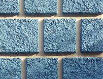 Detail of the facade with blue squares. Detail of the old facade with blue squares Stock Image