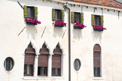 Detail of a facade of a building with flowers in Venice. Italy stock photography