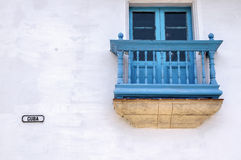 Detail of a facade of a colonial house in Havana. Blue balcony on a white wall in Cuba street, Old Havana royalty free stock photography