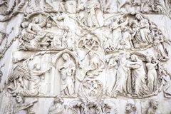 Detail of the facade of the Duomo of Orvieto, Italy. Marble bas-relief representing episodes of the bible stock image