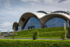 Detail of the facade of a modern building in a curved shape. royalty free stock photo
