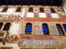 Detail of the facade of the old building decorated in Trento in Stock Photos
