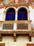 Detail of the facade of the old building decorated in Trento in Royalty Free Stock Photos
