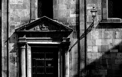Detail of the facade of an old church, black and white. Detail of the facade of an old church with lamppost, black and white, high contrast, landscape cut Stock Photography