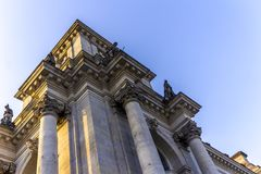 Detail of the facade of the Reichstag building. Blue sky and grey stones. Berlin, Germany Royalty Free Stock Photos