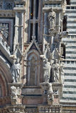Detail of the Facade of Siena dome (Duomo di Siena), Italy. Details of the beautiful gothic facade of the dome in Siena Stock Photo