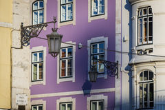 Detail of the facade and traditional lamp posts of old buildings in downtown Lisbon Royalty Free Stock Images