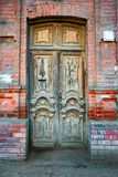 Detail of the facade with vintage wooden door in Astrakhan, Russia Royalty Free Stock Photography