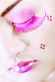 Detail of a face with colorful makeup Royalty Free Stock Photography