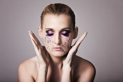 Detail of a face with fashion make up with tears Royalty Free Stock Images