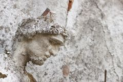 Detail of the face smashed historic statues. Torso of ancient statues. Lost sculpture. Royalty Free Stock Images