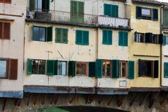 Detail of the famous Ponte Vecchio Bridge over Arno River, Florence, Italy - Image royalty free stock photo