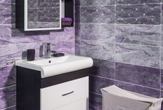 Detail of fashionable bathroom in purple Royalty Free Stock Image