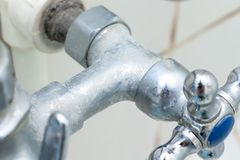 Detail of faucet with limescale or lime scale on it, dirty calcified and rusty shower mixer tap, close up.  stock photo