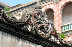 Detail featured sculpture as part of architecture. Exquisite sculpture detail of architecture in classical style in Xiamen city, South of China, shown as Stock Photo