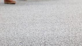 Detail of feet crossing a crosswalk.02-02 stock video footage