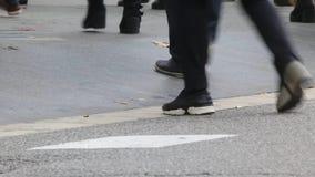 Detail of feet crossing a crosswalk.02-06 stock video footage