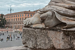 Detail of the feet of a statue in rome Stock Image