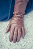 Detail of a female brown leather glove Stock Photos