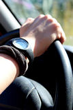 Detail of female hand on the steering wheel of a car Stock Photos
