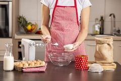 Woman making a cake stock images