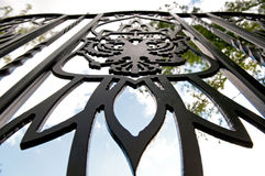 Detail of a fence. Detail of a metal fence with a blazon Stock Images