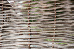 Detail of a fence from brushwood Stock Images