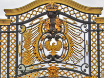 Detail of the fence, Buckingham palace, England. Golden detail of the fence of  Buckingham palace, England Royalty Free Stock Image