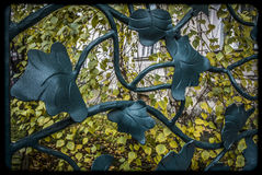 Detail of a fence. A fence with leaf-like ornaments Stock Photography