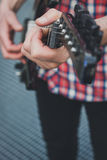 Detail of fingers playing electric guitar Stock Photography