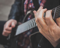 Detail of fingers playing electric guitar Stock Image