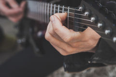 Detail of fingers playing electric guitar Royalty Free Stock Images
