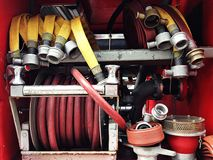 Detail of firetruck. Fire hose and other equipment in a truck, fire water hose connector on board a fire engine, detail of firetruck, firetruck interior with Royalty Free Stock Photos