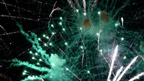 Detail of fireworks. slow motion. Detail of fireworks, Large explosions in green and blue colors. slow motion