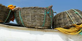 Detail of fisherman boat , with net and basket royalty free stock photos