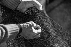 Detail fisherman mending Stock Images