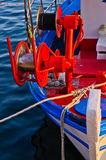 Detail of a fishing boat with red colorful machinery Stock Photos