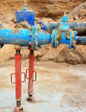 Detail of fittings, 250mm and 150mm gate valves, reduction joint members in drink water system. Repairing of piping in excavation pit. Extreme kind of Royalty Free Stock Image