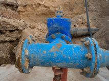 Detail of fittings, 250mm and 150mm gate valves, reduction joint members in drink water system. Repairing of piping in excavation pit. Extreme kind of Royalty Free Stock Photography