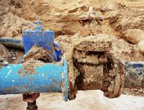Detail of fittings, 250mm and 150mm gate valves, reduction joint members in drink water system. Repairing of piping in excavation pit. Extreme kind of Royalty Free Stock Images