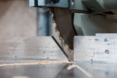 Detail of fixed  circular buzz miter saw blade. And table Royalty Free Stock Image