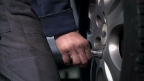 Detail of fixing the screw back to the tire. Vulcanisers unscrewing the rims and changing the tires stock video footage