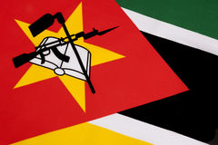 Detail on the flag of Mozambique. The flag of Mozambique was adopted on 1 May 1983. It includes the image of an AK-47 with a bayonet attached to the barrel and Stock Photo