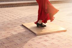 Detail of a flamenco dancer`s feet performing in a street of a Spanish city. Stock Photos