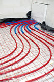 Detail of floor heating system. Details of the pipes in a floor heating system installed in a house under construction royalty free stock photos