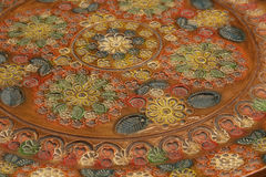 Detail of floral decoration on engraved ceramic dish Stock Images