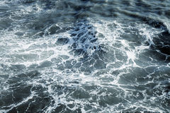 Detail of flowing water creating pattern and texture Royalty Free Stock Photos