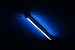 Detail of a fluorescent light tube mounted on a wall Royalty Free Stock Photography