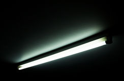 Detail of a fluorescent light tube on a wall. Fluorescent light tube with copy space for any design stock photos